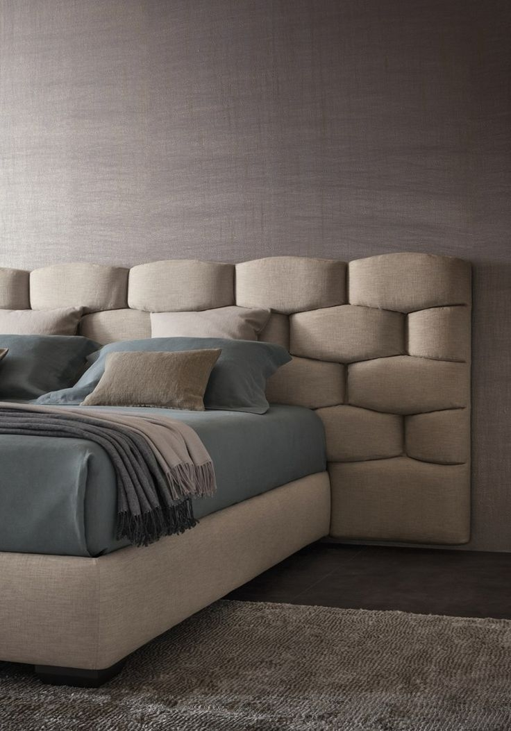 The most unique upholstered bed I've ever seen. This takes a spin of finesse by showcasing a brick-like layout but instead of rough stone, you have something that is more soft to the touch.