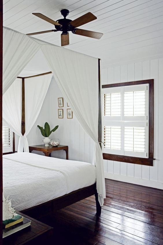 A canopy style bed in a Nantucket style bedroom will surely put out the mellow vibes and make you feel like like you're at the beach. A little sand and you're set!