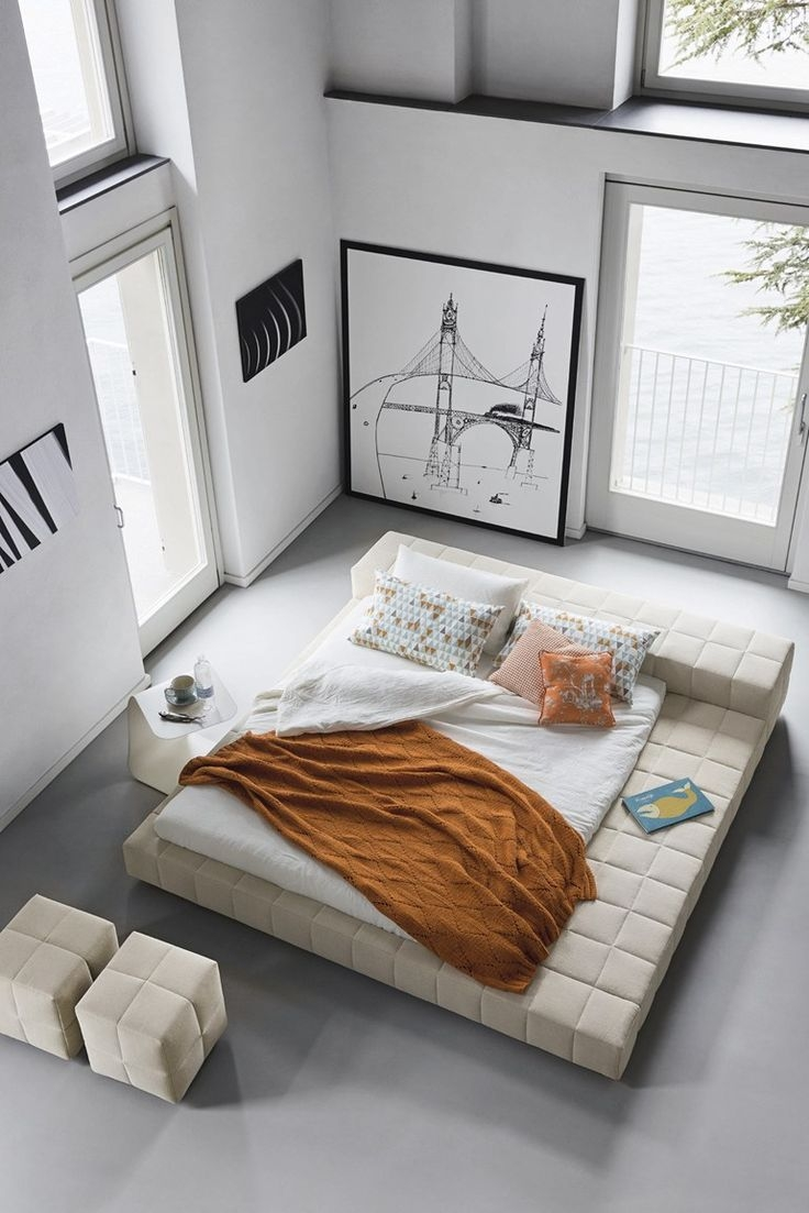 A quality platform bed is one you could spend all day on. A fabric frame wrapped around a comfy mattress with the convenience of a ledge to put your stuff. What more could you want?
