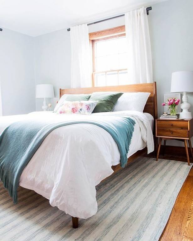 Going with blues and greens in a bedroom can help to decrease stress by bringing in nature-occurring harmonious tones. The wood furniture is a sure way to go with this theme.