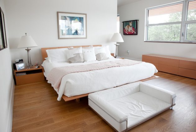 Wood floors help your bedroom take on that natural ambiance. Choosing lighter colors to accent the wood make your bedroom feel larger.