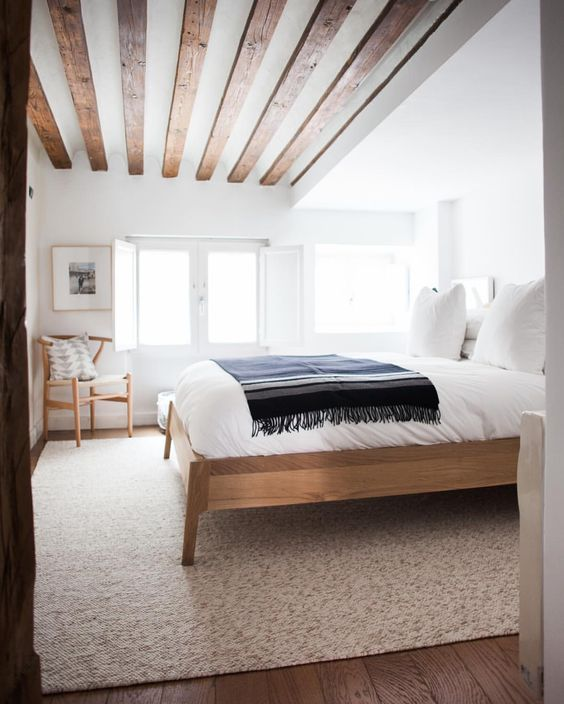 Country style bedrooms are a great way to spice up your home. This features distressed boards that line the ceiling, and a distressed furniture to go with it. Best part is, the more you beat up your furniture, the better it looks.