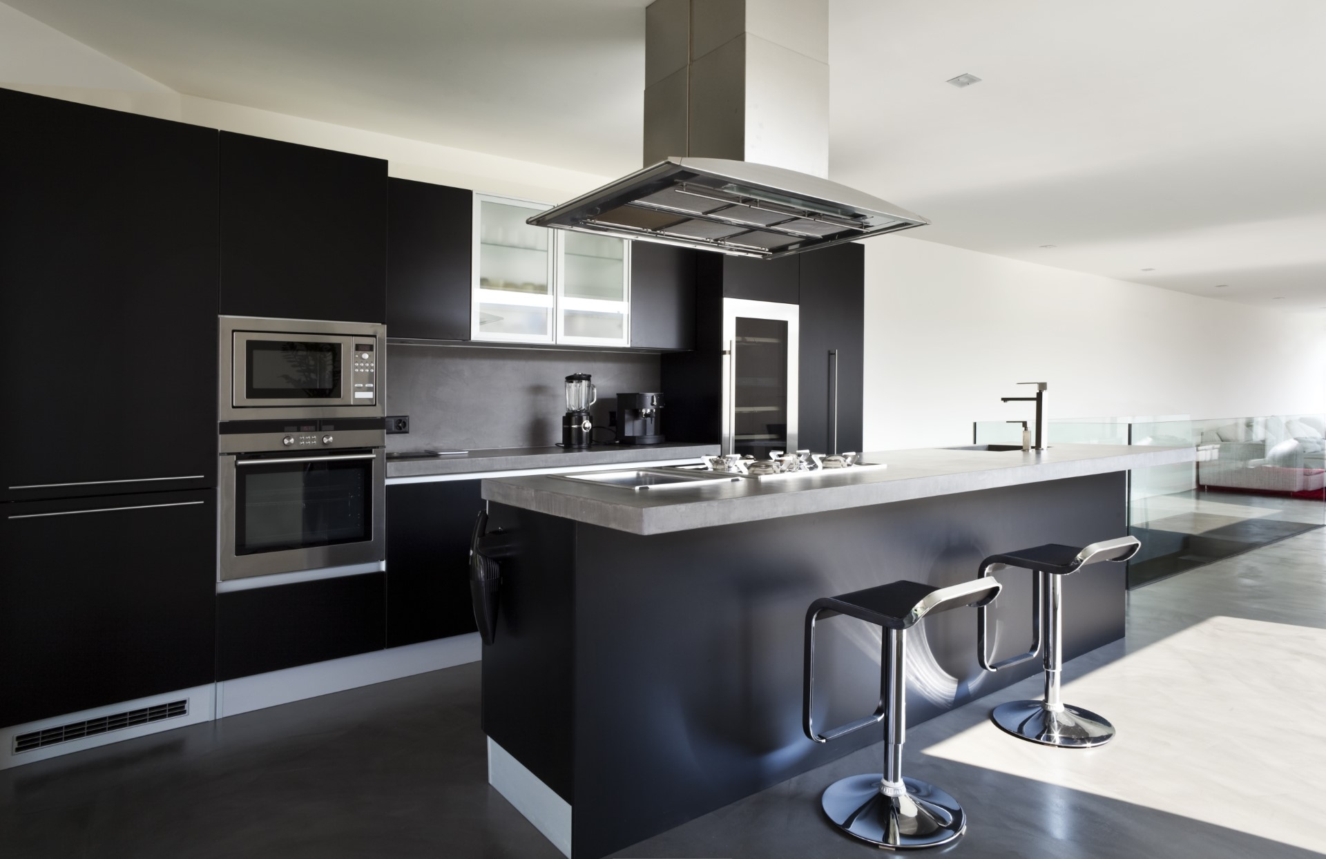 Dark cabinets carry the functionality of being low maintenance and seemingly always looking good. They're great at hiding finger prints and when you add in stainless steel, it makes it shine.