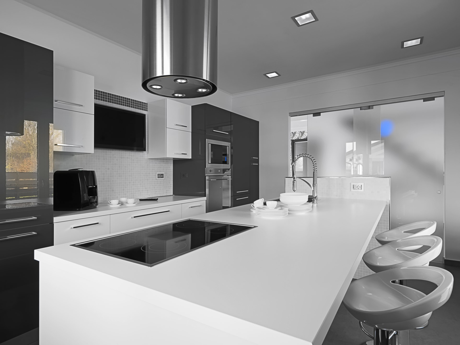 For the modern minimalist, this design carries the simplicity in only providing the bare essentials for the kitchen. A design like this makes cleanup a breeze because there are'nt a lot of small crevices and everything can be easily wiped down.