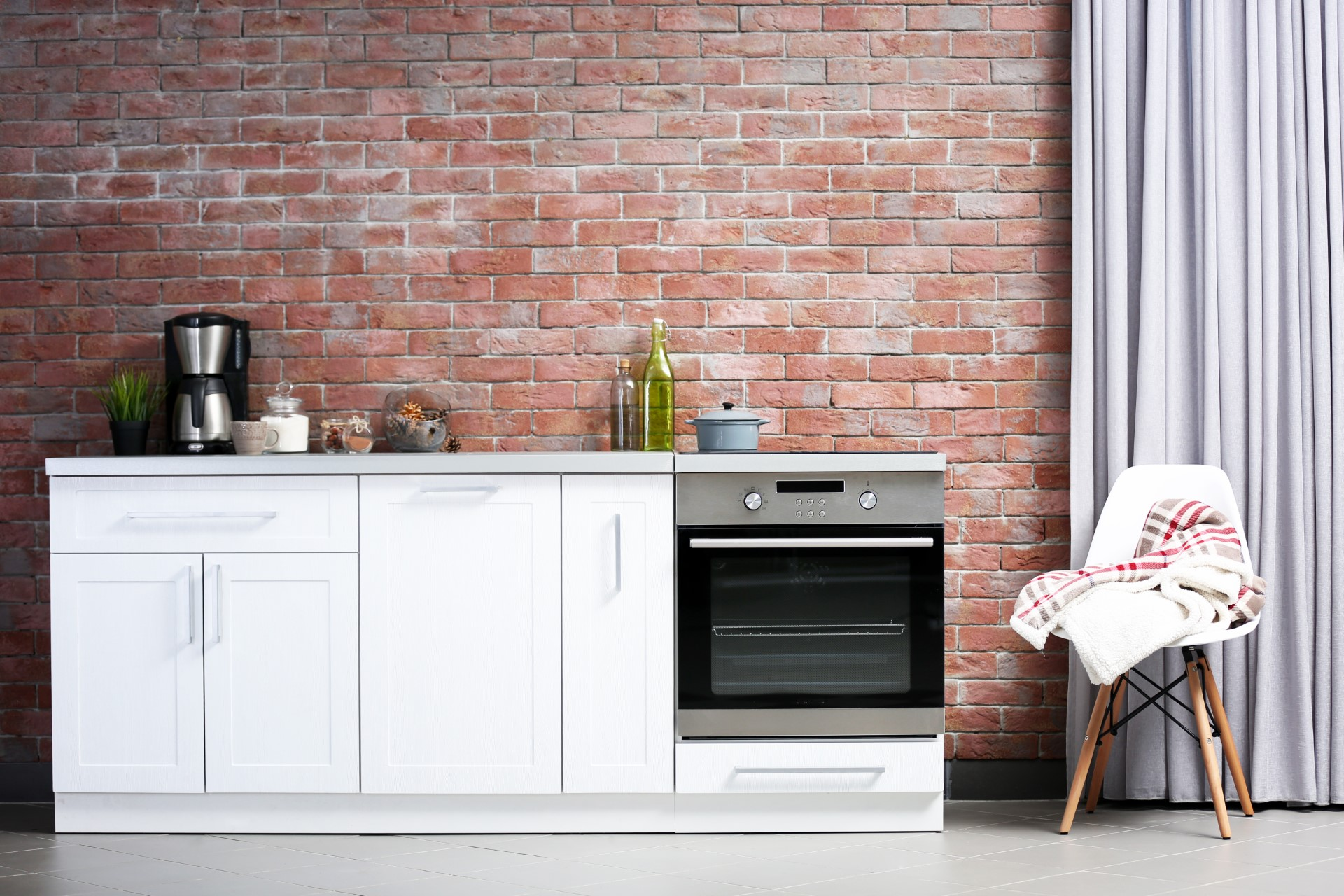 A stone wall is an excellent idea if you're going for an old-school Brooklyn type of feel. It really takes that contemporary to a new level if you can match it with adequate wood and stainless to get diversity through multiple elements.