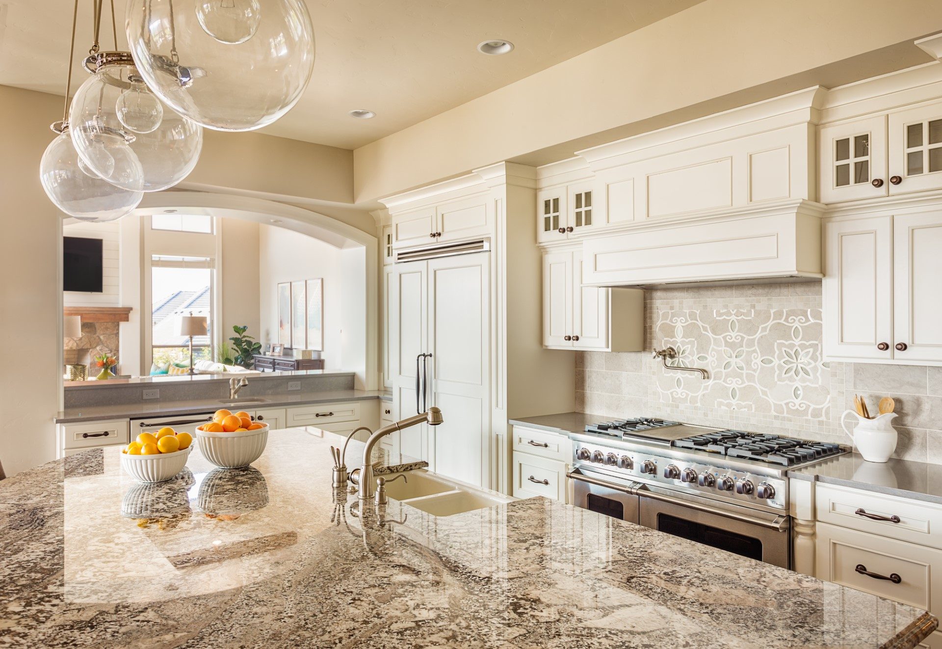 This is a beautiful kitchen design with a granite slab that is sure to amaze. A kitchen like this gives off a Cape Cod type of ambiance, and the best part is it has two sinks so your kids can do dishes with you.