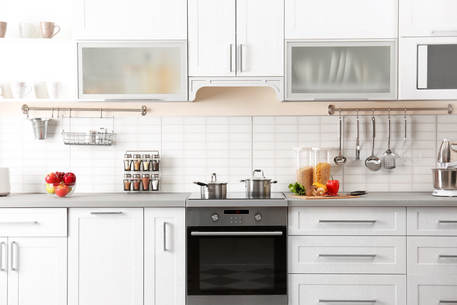 Going with the white kitchen design such as this is an excellent way to give the illusion of a larger space. If you have a smaller kitchen and you're looking to maximize your space, this is the layout you need.