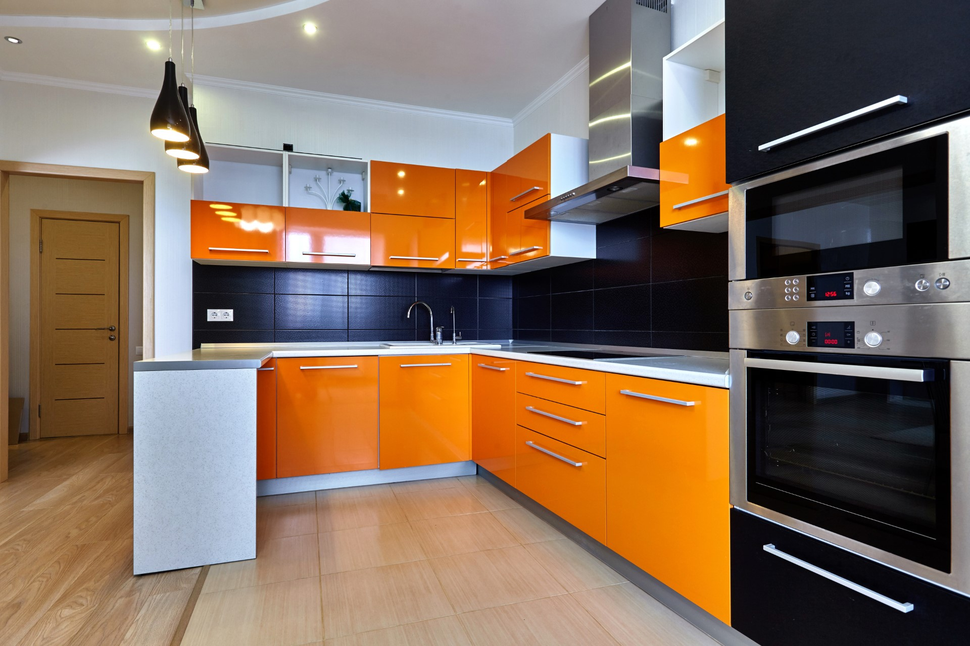 A bright orange kitchen is probably the thing you would least expect to see, but it's awesome! It's for the type of person who has no boundaries, and want something to become a centerpiece for their home. Definitely the type of abstract decoration I would bring to my home.