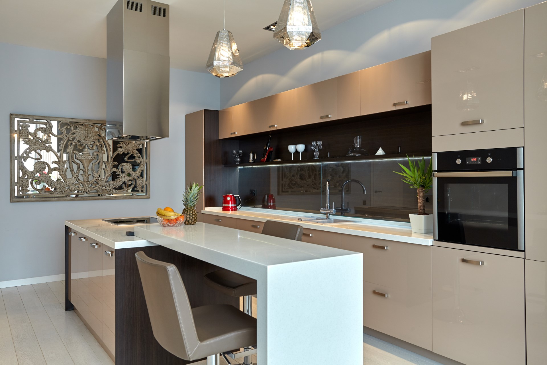 This eccentric modern kitchen has a touch of Indonesia design while keeping a minimalist structure about it. Great for someone who likes to keep it simple.