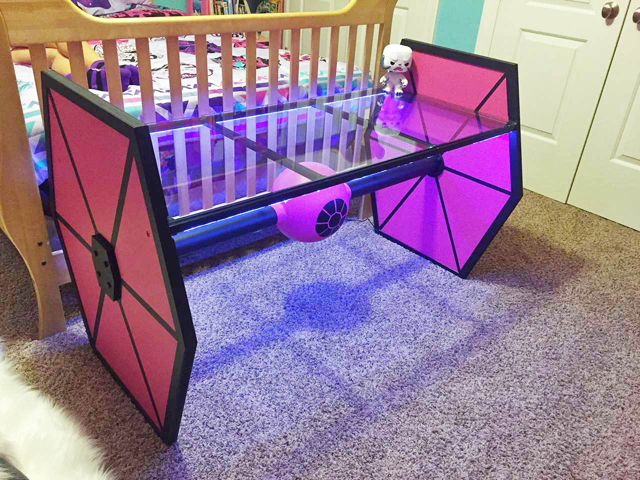 Not something you see every day, this pink tie fighter glass table is one-of-a-kind.