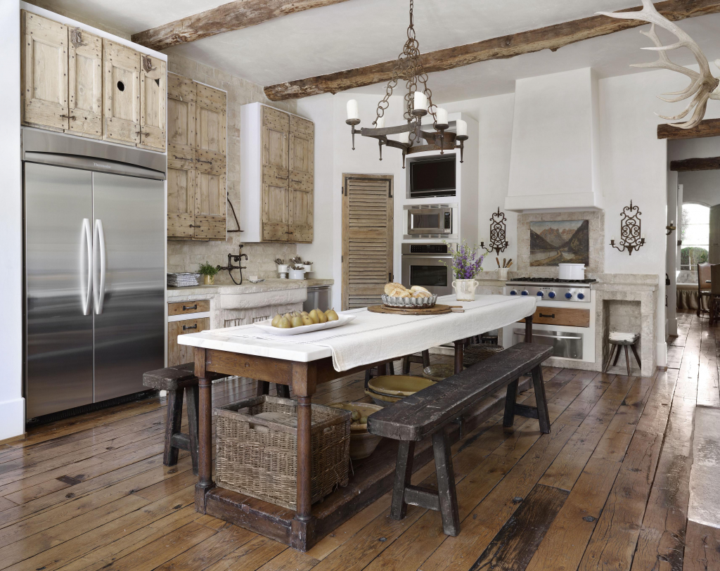 When you're going for a modern farmhouse rustic feeling kitchen, dark floors are going to be a lot more durable and easier to maintain. This one features bench seats and an island countertop is well as a built-in wall stove to cook to your hearts content.