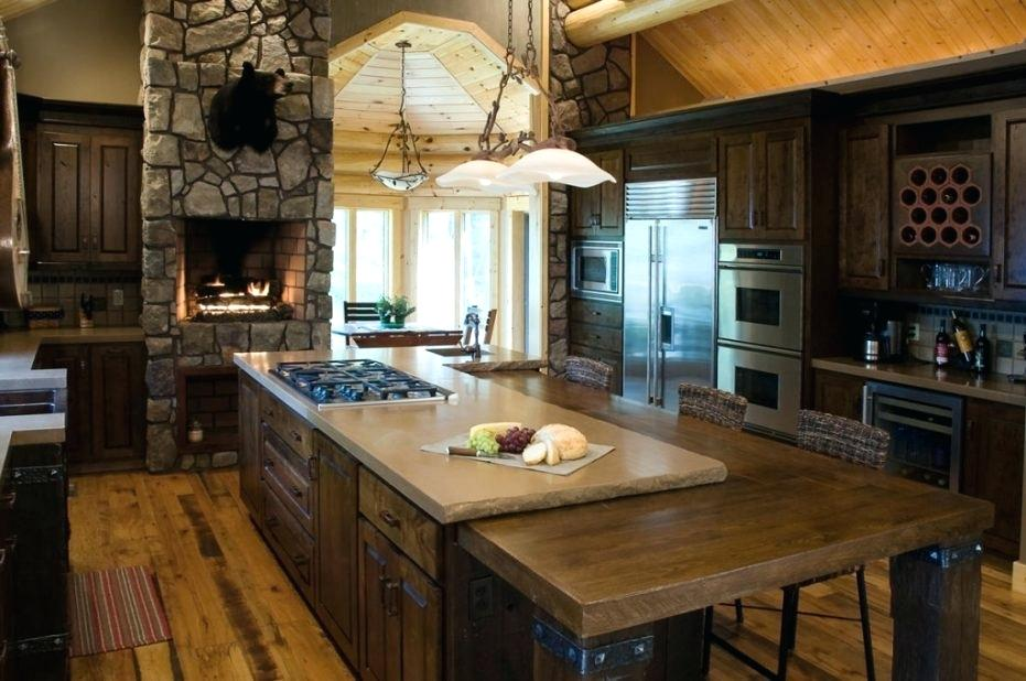When you're bring the family together, there's no better way to do it than bringing in a fire pit to this countryside farmhouse design. It even features an area to store all your wine bottles, an island counter stop with tons of seating to eliminate the need for a table, and lighting over the built-in gas stove. This is truly a dream rustic kitchen idea.