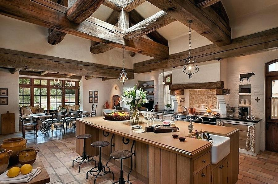 This is great if you have vaulted ceilings going with the more aggressive stained wood beam to maximize that country farmhouse feeling. It's great to have an island countertop with seeding and a Wolf stovetop in this luxury kitchen.