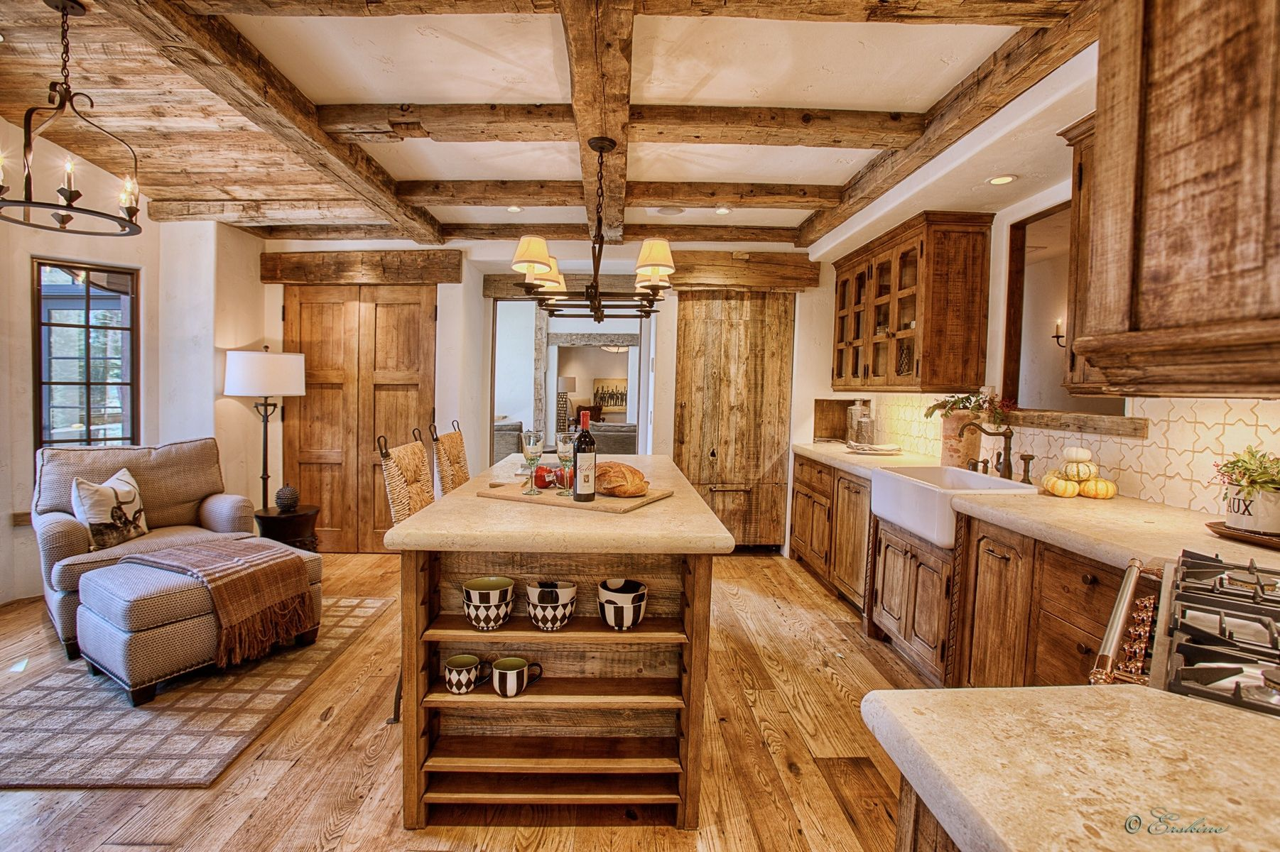 Adding wood beams to your ceiling provides a lot of warps for your kitchen. When you're remodeling your kitchen it might be a good idea to add island countertop with seating to help maximize space.