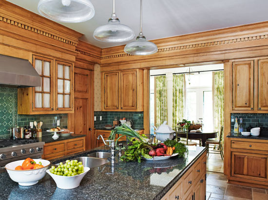 A little bit more an elegant design, this dream farmhouse kitchen features granite countertops for extended durability.