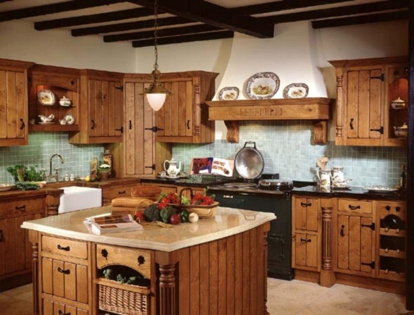 This rustic countryside farmhouse kitchen with island countertop and wood beams on the ceiling is great for entertaining.